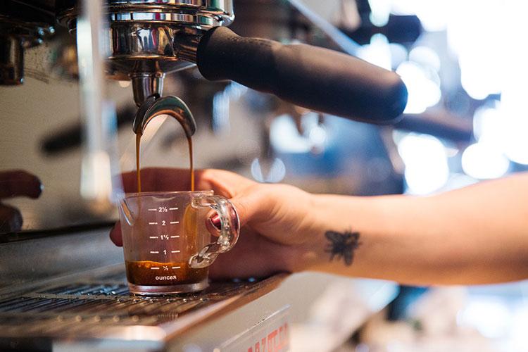Server making an espresso