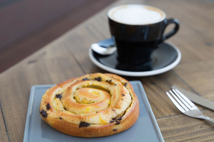 Espresso coffee with a swirly pastry